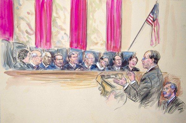 Paul Clement, with Solicitor Gen. Donald Verrilli Jr., seated, addresses the Supreme Court justices in this artist's rendering of arguments on the Defense of Marriage Act.