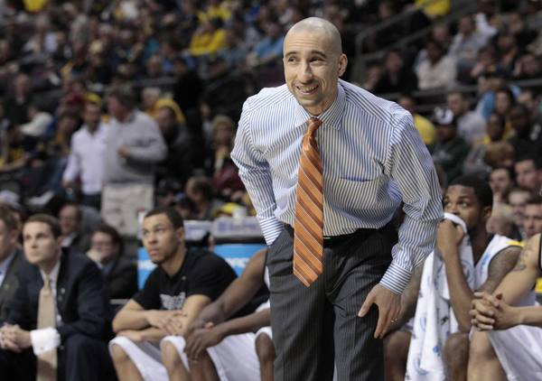 VCU coach Shaka Smart looks on as they play Akron during the first half.