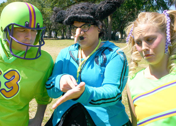 "Coach Viola Swamp (Amanda Leakey, center) has instruction for Patrick (Nathan Sebens) and Lauren (Lauren Butler) in ""Miss Nelson Has a Field Day."""