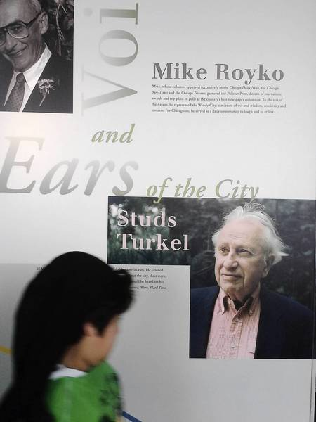 "A visitor to the 103rd floor of the Willis Tower studies an exhibit on Studs Terkel on Wednesday. His name is misspelled ""Turkel"" in the headline."
