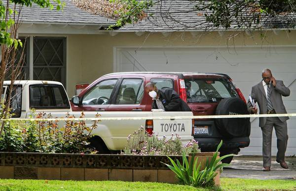 A vehicle is dusted for prints in the driveway of a home in the 8800 block of Oakdale Avenue near Nordhoff Street in Northridge, where a 10-year-old girl disappeared during the night. According to the preliminary investigation, the girl's mother saw her in her room about 1 a.m., but when she returned to the bedroom about 3:30 a.m., the child was gone. The woman called police.