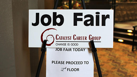 A sign alerts employment seekers to a job fair hosted by Catalyst Career Group at Embassy Suites in Lombard on Aug. 29, 2012.