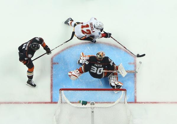 Jarome Iginla is pursued by Cam Fowler of the Ducks as goaltender Viktor Fasth defends his net in the Flames-Ducks game on March 8.