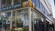 Cypriot banks to open for first time in two weeks
