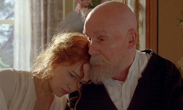 "Christa Theret as Andree Heuschling and Michel Bouquet as Pierre-Auguste Renoir in the movie ""Renoir."""