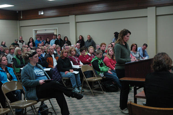 Charlevoix second grade teacher Dawn Hovie speaks to the board in favor of the two-building system Monday night at a special meeting.