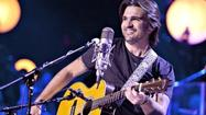 "When international rock star and humanitarian Juanes began putting together his new memoir, ""Chasing the Sun,"" he started with pictures. The handsome book, nearly 300 pages, is filled with the kind of candid shots that fans will eat up, from his days as a pudgy schoolboy to angry long-haired rocker skirting the violence of Medellin, Colombia, to recent scenes on tour and in Miami, where he now spends most of his time."