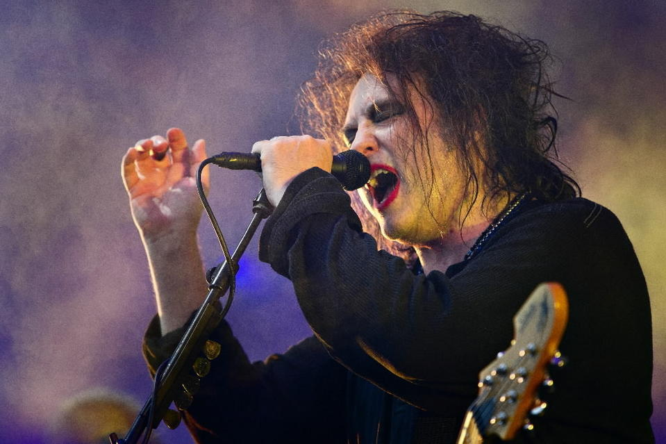 Robert Smith of the band The Cure performs at the Roskilde Festival last year.
