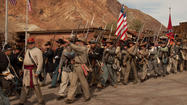Civil War re-enactment participants take part in a parade at the Calico Ghost Town.