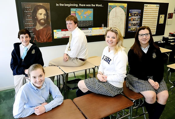 St. Maria Goretti students Jason Marinelli, left, Tess Skehan, Will Snyder, Laura Winalski and Megan Rock are in a religion class taught by Theresa Doub.