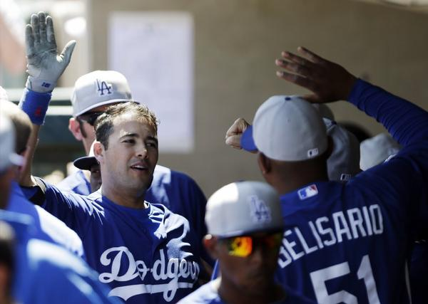 Dodgers' Andre Ethier celebrates in the dugout after his two-run home run against the Oakland Athletics on Sunday.