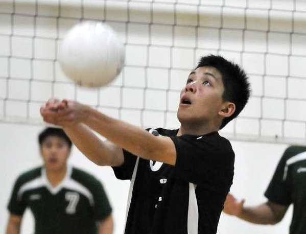 Glendale Adventist Academy's Justin Ng bumps the ball against Providence in a Liberty League boys' volleyball match at Glendale Adventist Academy in Glendale on Wednesday, March 27, 2013.