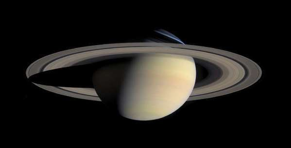 This photo taken by the Cassini Saturn Probe on Oct. 6, 2004, shows the planet Saturn and its rings. A detailed analysis of the spacecraft data finds the rings and moons are abundant in water ice, and that the moon Prometheus may have arisen from the planet's rings.