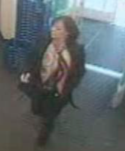 Police released surveillance photos of the woman they suspect of stealing a wallet from a local restaurant.