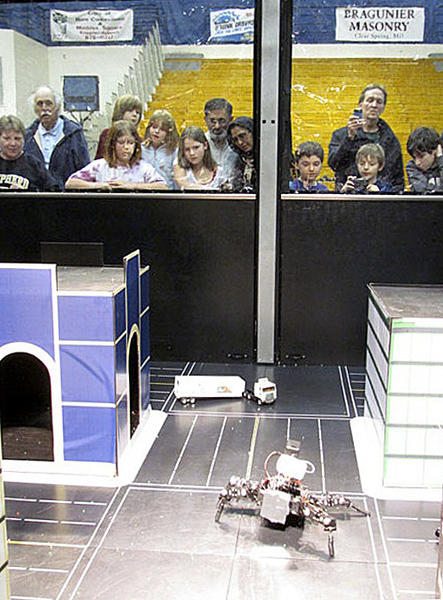 Audience watches robots at ShepRobo Fest during the 2012 event.