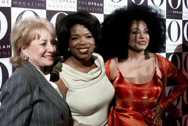 "Television personalities Oprah Winfrey (C) and Barbara Walters (L) pose for photographers with singer Diana Ross (R) at the launch party for ""O, The Oprah Magazine"" in New York in 2000."