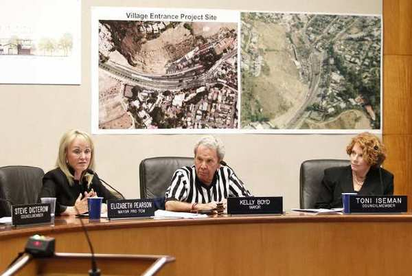 Mayor Pro Tem Elizabeth Pearson, left, and Councilwoman Toni Iseman, right, presented their seperate and differing proposals for the new Village Entrance project site during a special meeting where Mayor Kelly Boyd, middle, wore a referee shirt for the occasion.