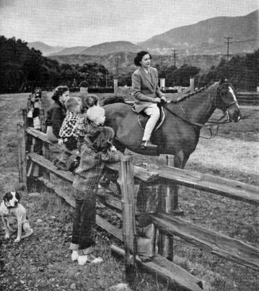 Children admire Mrs. Theodore Camlin, astride Hylo Ladd, in advance of the 1953 Flintridge Hunter and Jumper Horse Shows, expected to be the final such event held on the Spalding hunter trials field, as the land had been sold for development as a public school site. Today, La Canada High is on the property, at the corner of Foothill Boulevard and Oak Grove Drive.