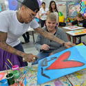 Chris Brown Joins Forces With Artist Romero Britto in Support of Best Buddies International