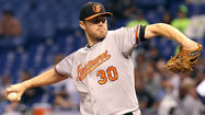 The Orioles made a move Thursday night that likely solved their Opening Day roster logjam — for a few days, anyway.