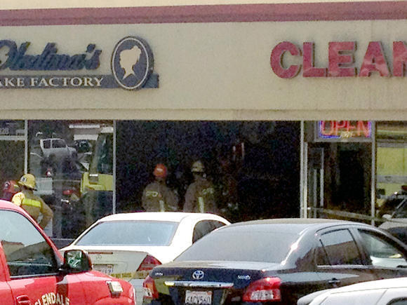 Emergency workers at the crash site at Oledina's Cake Factory in Glendale.