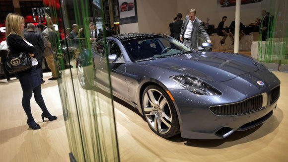 A Fisker Karma is on display at the booth during the 83rd Geneva Motor Show this month.