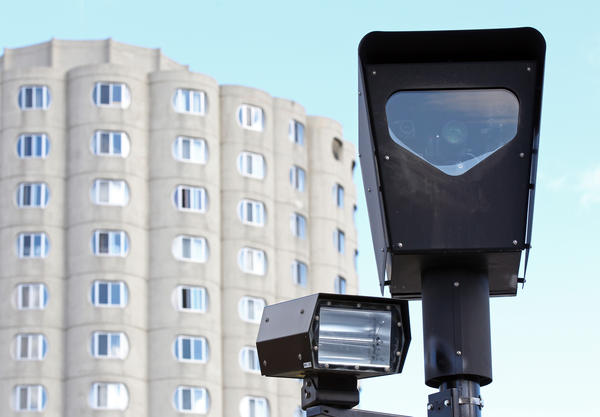 A Redflex red-light camera operates at West Cermak Road and South Canal Street.