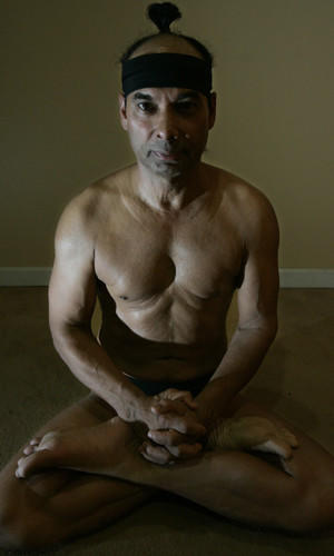Yoga master Bikram Choudhury assumes the lotus position.