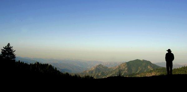 A layer of smog sits above the San Joaquin Valley in this early-morning view from Beetle Rock in Sequoia National Park.