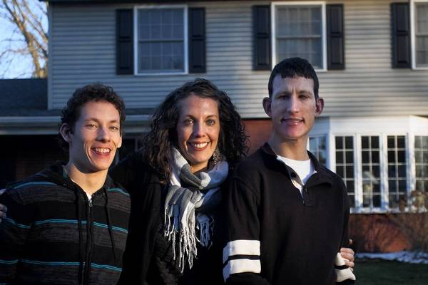 From left, Johnny Dickey, 21, his sister Margaret Dickey, 32, and her brother Patrick Dickey, 27, pose for a photograph at their parents home March 21, 2013, in Mishawaka, Ind. Margaret has helped look after her brothers, both of whom are autistic, since she was in high school. ""