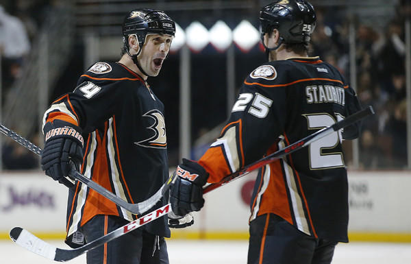 Ducks defenseman Sheldon Souray (44) celebrates with teammate Brad Staubitz after scoring a goal against the Flames earlier this month at the Honda Center.