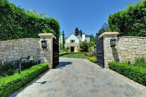 The Paul Williams-designed estate sits on 1.38 acres.