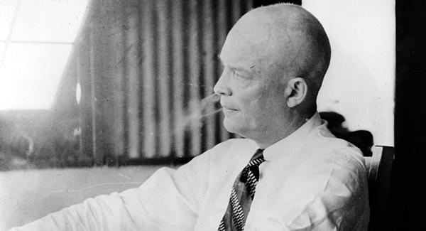 "Colonel Dwight Eisenhower smoking a cigar ""Rescue in the Philippines."""