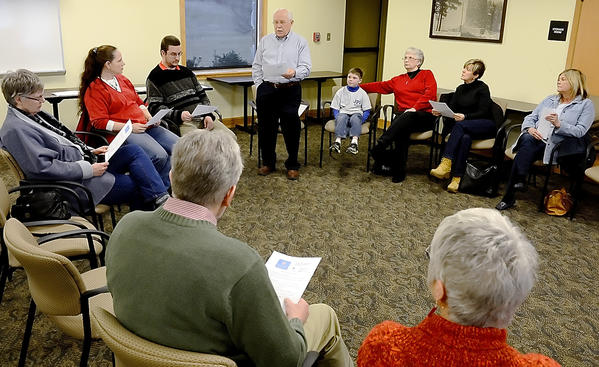 Quentin Fleming, standing, leads a meeting for a call of a petition and letter to stop gun violence. The meeting held at Boonsboro Free Library was hosted by the Western Maryland chapter of Organizing For Action.