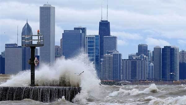 Waves crash at the lakefront near the 39th Street beach early Monday morning, March 25, 2013.