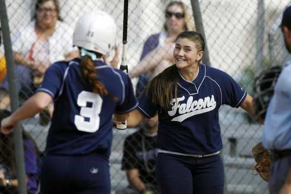 Crescenta Valley High's Hannah Cookson, left, receives a high five from Chloe Fairbrother in an 8-6 win over Hoover Thursday. Cookson hit a two-run homer in the sixth to end the scoring.