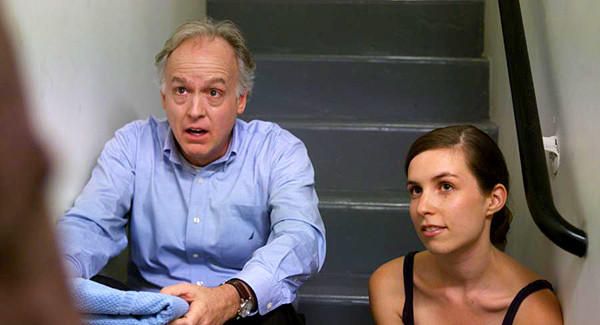"A soul searching conversation between Asher Bluefield (Reed Birney) and his daughter-in-law, Molly (Sophia Takal), is interrupted on the 28th floor stairwell, where one can always find the best Halloween candy, in Jeff Lipsky's ""Molly's Theory of Relativity."""