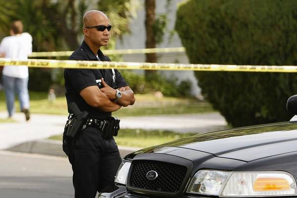 L.A. police officers block off access in the Northridge neighborhood where a 10-year-old girl was reported missing early Wednesday. She was found that afternoon about six miles away.