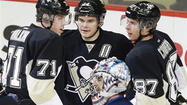 PITTSBURGH (AP) — Pascal Dupuis scored twice and Evgeni Malkin had a goal in his return to the lineup, leading the Pittsburgh Penguins to a 4-0 victory over the Winnipeg Jets on Thursday night for their 14th straight win.