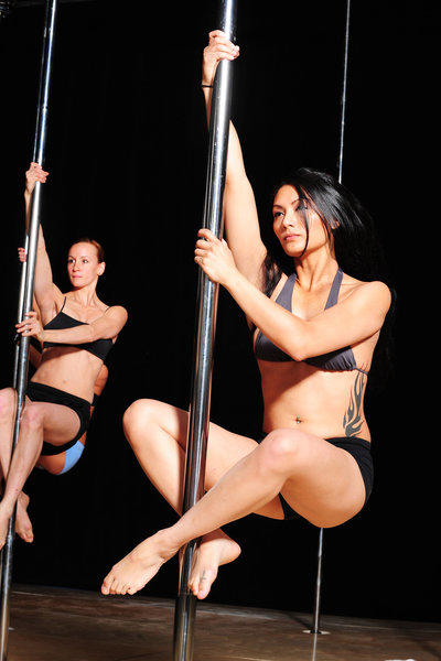 Women get a workout during a pole fitness class in Las Vegas. In honor of National Pole Dance Day, Shine Alternative Fitness is offering $10 pole dancing classes.