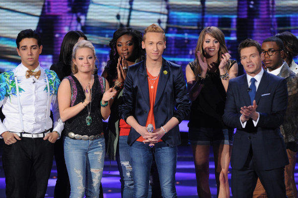 "Devin Velez, center, has been eliminated on ""American Idol."""