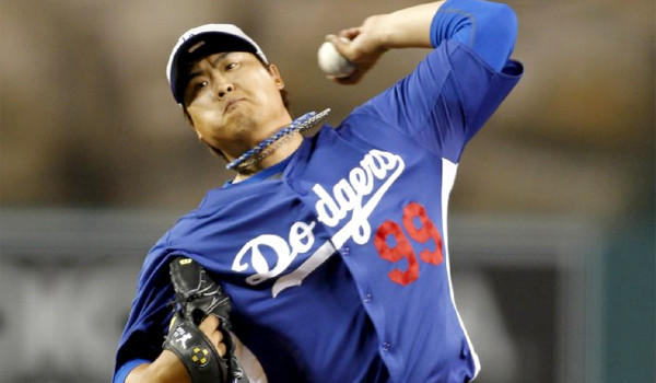 South Korean pitcher Hyun-Jin Ryu retired all 12 Angels batters he faced in the Dodgers' 3-0 victory in the first of three exhibition games in the Freeway Series.