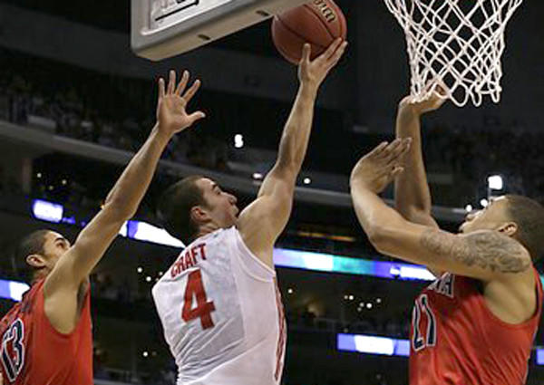 Ohio State guard Aaron Crafts splits two Arizona defenders for a basket in the first half Thursday night.