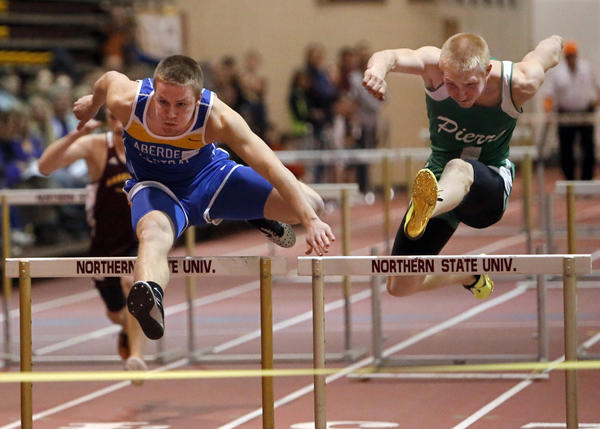 Aberdeen Central's Josh Hilgemann, left, leads Pierre's Shay Reinke as they clear the last hurdle in the boys 55 meter hurdle race Thursday at the Class AA Al Sahli Invitational Indoor Track Meet at Wachs Arena. photo by john davis taken 3/28/2013