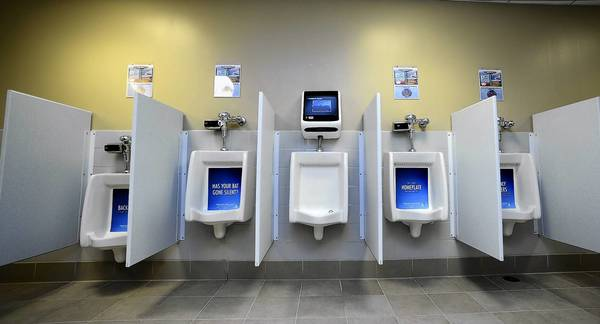 At center is a new video game urinal in a men's rest room at Coca-Cola Park in Allentown. No such devices have yet been made available for women.