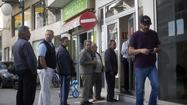The president of Cyprus said the risk of bankruptcy has been contained and the country has no intention of leaving the euro.
