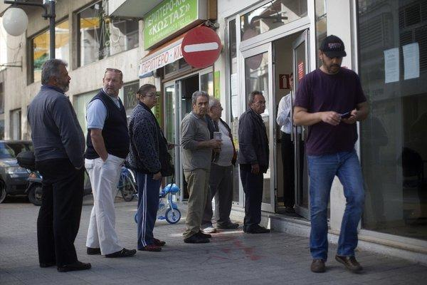 Customers line up Friday outside a bank in Nicosia, Cyprus. It was the second day banks were open, following a nearly two-week closure to avert a run on deposits.