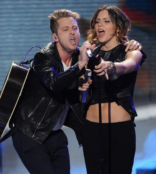 "Former Idol Katharine McPhee was on hand to sing with One Republic, sporting a drastic new hairdo. She must have realized that since ""Smash"" is not a smash, she has go back to being a singer again."