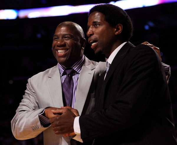 Magic Johnson, left and A.C. Green