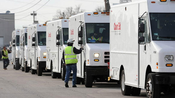 ComEd trucks await deployment to New York to help with hurricane cleanup in October.
